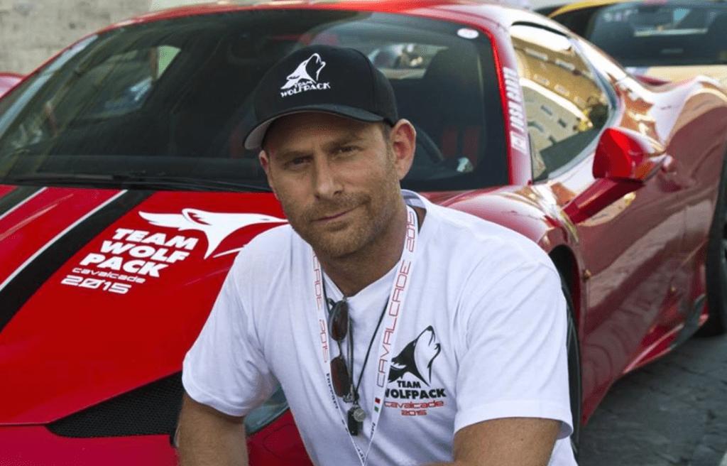 Joshua Cartu with Ferrari